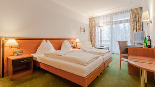 Hotel Alpenland Sporthotel St. Johann Wohnbeispiel